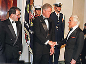 United States President Bill Clinton, center, and President Romano Prodi of Italy, left, welcome Jack Valenti, President and CEO, Motion Picture Association of America, right, to the Official Dinner in the Prime Minister's honor at the White House in Washington, DC on May 6, 1998.<br /> Credit: Ron Sachs / CNP