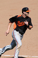 Baltimore Orioles Nolan Reimold #14 during a spring training game vs. the Philadelphia Phillies at Bright House Field in Clearwater, Florida;  March 8, 2011.  Philadelphia defeated Baltimore 4-3.  Photo By Mike Janes/Four Seam Images