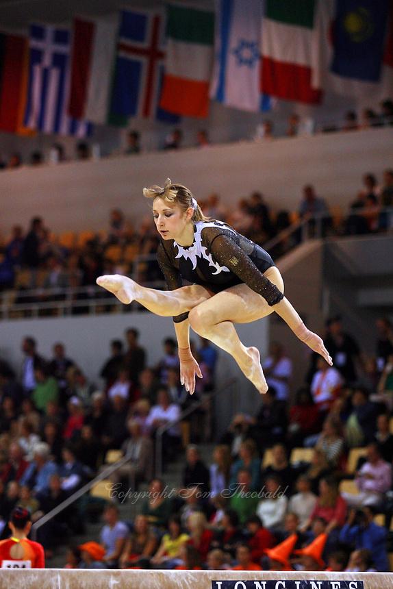 Oct 17, 2006; Aarhus, Denmark; Marina Proskurina of Ukraine performs cossack jump on balance beam during women's gymnastics team competition at 2006 World Championships Artistic Gymnastics.