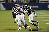1 October 2011:  FIU defensive back Jose Cheeseborough (27) and linebacker Jordan Hunt (25) combine to tackle Duke tight end Danny Parker (88) in the second quarter as the Duke University Blue Devils defeated the FIU Golden Panthers, 31-27, at FIU Stadium in Miami, Florida.