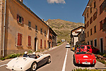 Classic British cars, part of the 24th British Class Car Meeting in St. Mortiz, Switzerland. Cars drive through the town of Montespluga on the way to the Spluga pass