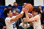 Alton Marquette teammates Brett Terry (left) and Spencer Cox both grab for a rebound. Alton Marquette played Roxana in the Class 2A Roxana boys basketball regional final at Roxana High School in Roxana, Illinois on Friday February 28, 2020. <br /> Tim Vizer/Special to STLhighschoolsports.com