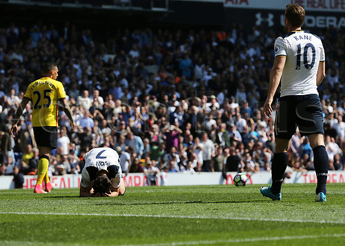 April 8th 2017,White Hart Lane, Tottenham, London, England; EPL Premier league football, Tottenham Hotspur versus Watford; Son Heung-Min of Tottenham Hotspur falls to his knees in dejection after missing a chance to score a hat trick with Harry Kane of Tottenham Hotspur looking on