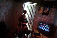 "Sons of Rastas play video games in a small game shop owned by a member of ""the twelve tribes of Israel, a Rastafari movement  in Shashamane, a village that hosts more than 300 Rastafarians Families, in Ethiopia on on Saturday March 22 2008.///..The Rastafarians, who are mainly from Jamaica, started migrating to Ethiopia 45 years ago, when Haile Selassie, whom they consider to be God incarnate, gave them 500 hectares of land on which to settle..Since the first 12 Jamaican settlers in 1963, the community has grown to over 200 families..The Rastafarian community insists that a mass exodus of Jamaicans to Ethiopia would not be a burden, despite the poverty and economic difficulties faced in the country..Some of them are skilled tradesmen such as carpenters and builders..Others are shop owners and they say that over the decades they have played an important role in the development of Shashamene..In January 2005 there were reports in the media that Bob marley's remains were to be exhumed and then reburied at Shashamane. His wife Rita Marley described Ethiopia as his spiritual home, provoking controversy in Jamaica, where his remains lie..At the beginning of the following month, thousands of fans gathered in Shashamane for a month of celebrations for what would have been Marley's 60th birthday. Until 2005 his birthday celebrations were always held in Jamaica. These events brought Shashamane to wider prominence throughout the world.."
