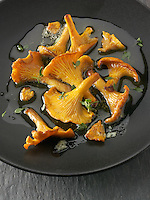 Wiild organic chanterelle or girolle Mushrooms (Cantharellus cibarius) or sauteed in butter and herbs