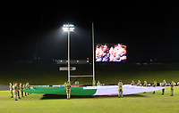 Soldiers hold the Welsh flag as the Wales U20's players sing their national anthem<br /> <br /> Photographer Richard Martin-Roberts/CameraSport<br /> <br /> Six Nations U20 Championship Round 4 - Wales U20s v Italy U20s - Friday 9th March 2018 - Parc Eirias, Colwyn Bay, North Wales<br /> <br /> World Copyright &copy; 2018 CameraSport. All rights reserved. 43 Linden Ave. Countesthorpe. Leicester. England. LE8 5PG - Tel: +44 (0) 116 277 4147 - admin@camerasport.com - www.camerasport.com