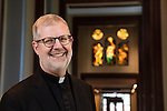 The Rev. Dennis H. Holtschneider, C.M., president of DePaul University, is seen in a portrait in the John T. Richardson library on DePaul's Lincoln Park campus Monday June 29, 2015. (DePaul University/Jeff Carrion)