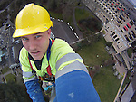Steeplejack Ian Millington at the top of the 30 meter flag pole at the Celtic Manor Resort, working to repair damage caused by high winds...MANDATORY CREDIT: STEVE POPE..23.01.12.©Steve Pope