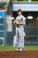Arkansas Razorbacks relief pitcher Jacob Burton (21) looks to his catcher for the sign against the Texas Longhorns in game six of the 2020 Shriners Hospitals for Children College Classic at Minute Maid Park on February 28, 2020 in Houston, Texas. The Longhorns defeated the Razorbacks 8-7. (Brian Westerholt/Four Seam Images)