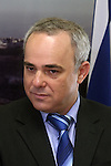 "Israeli Finance Minister Yuval Steinitz speaks to the press after receiving the Bank of Israel report from Bank of Israel Governor Stanley Fischer at the Finance Ministry in Jerusalem, Sunday, April 19, 2009. Stanley Fischer declared that ""the report says we are dealing with the current crisis relatively well"", although he did stress that he expects the decline to continue and that he believes that the Israeli economy has yet to reach its lowest point. Photo By: Emil Salman / JINI"