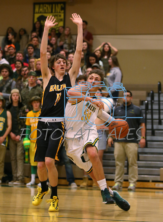 Manogue's Zachary Wurm drives past Galena's Josiah Wood at Manogue High School in Reno, Nev., on Tuesday, Feb. 11, 2014. Manogue won 51-29.<br /> Photo by Cathleen Allison