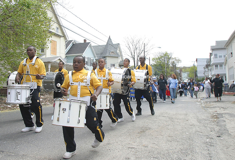 WATERBURY, CT - 26 APRIL 2008 - 042608JW01.jpg -- .Members of the Berkley Knights Drum Corp. lead members of the Walnut-Orange - Walsh neighborhood on a parade to Walsh Elementary School during the Walsh School Community Day Saturday morning Jonathan Wilcox Republican-American