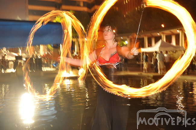 Jam for Joplin was a festival dedicated to relief for the tornado ravaged Joplin, MO.  Sunday, June 26th, 2011.  www.MotivePics.com Fire Dancers