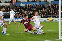 Aston Villa's John McGinn beats Swansea City's Mike van der Hoorn to the ball but sees it go wide <br /> <br /> Photographer Ian Cook/CameraSport<br /> <br /> The EFL Sky Bet Championship - Swansea City v Aston Villa - Wednesday 26th December 2018 - Liberty Stadium - Swansea<br /> <br /> World Copyright © 2018 CameraSport. All rights reserved. 43 Linden Ave. Countesthorpe. Leicester. England. LE8 5PG - Tel: +44 (0) 116 277 4147 - admin@camerasport.com - www.camerasport.com