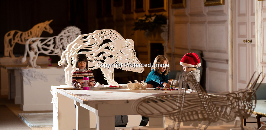 21/11/19<br /> <br /> L/R: Martha Johnstone (4), Polly Bamforth (5) and Edward Johnstone (6) play Creationary in the Long Gallery.<br /> <br /> Game On: A supersized snakes and ladder and other board games feature at the National Trust's Sudbury Hall, Derbyshire, where rooms have been converted into board games for Christmas. Visitors themselves are the playing pieces on the snakes and ladders board while other traditional board games featured include Scrabble, Guess Who and Cluedo.<br /> <br /> Full story:  https://rkp-press-releases.netlify.com/press-releases/2019-11-20-sudbury-hall-christmas-game-on-national-trust/<br /> <br /> <br /> All Rights Reserved: F Stop Press Ltd.  <br /> +44 (0)7765 242650 www.fstoppress.com