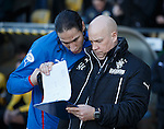 Bilel Mohsni checks Kenny McDowall's clipboard before kick-off