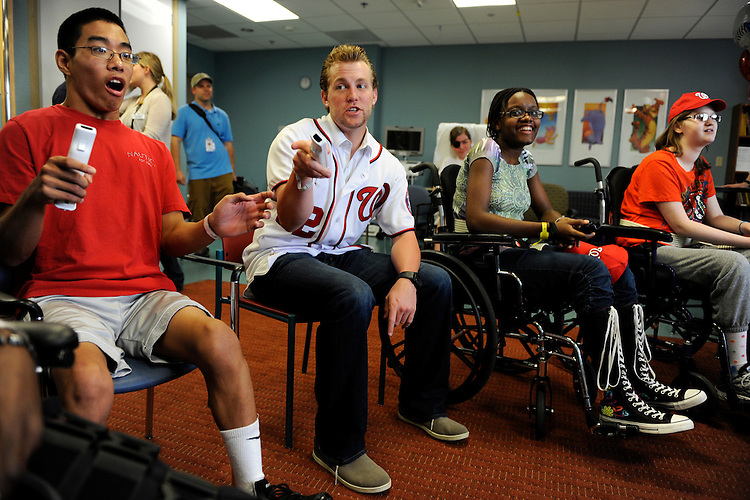 UNITED STATES - AUGUST 19:  Drew Storen, Washington Nationals relief pitcher, plays a bowling game on Nintendo Wii with Sammy Liang, 17, left, Delaney O'Hagan, 16, right, and Tervian Litchmore, 17, in the pediatric unit at the National Rehabilitation Hospital.  Storen visited the facility to participate in activities which are often used in patient's rehabilitation.  (Photo By Tom Williams/Roll Call)