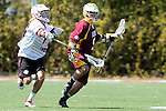 Orange, CA 05/02/10 - Connor Martin (Chapman # 99) and Robert Bocchicchio (ASU # 9) in action during the Chapman-Arizona State MCLA SLC Division I final at Wilson Field on Chapman University's campus.  Arizona State defeated Chapman 13-12 in overtime.