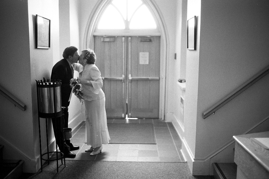 Septuagenarian newlyweds Roger and Joan Smith kiss after walking down the aisle at their wedding in Saugerties, N.Y.