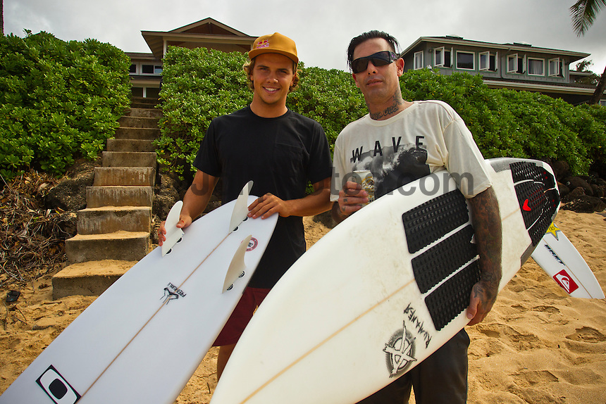 North Shore/Oahu/Hawaii (Monday, December 12, 2011) Julian Wilson (AUS) talks surfboard design with Christian Fletcher (USA). – Herbie Fletcher's Wave Warriors assembled at Off The Wall this afternoon to do a 2011 photo shoot. The shot was replicating a photo take in the 80's. Today's shoot included surfer such as Kelly Slater (USA), Rob Machado (USA), Nathan Fletcher (USA),  Christian Fletcher (USA), Julian Wilson (AUS) and John John Flores (HAW) among a host of others.. Photo: joliphotos.com
