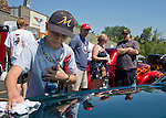 13 year-old Koby Richhart dusts his dad Bob's 1966 Mustang during the Hot August Nights Pre-Kickoff show and shine held at the Bonanza Casino in Reno, Nevada on Sunday, August 4, 2013.