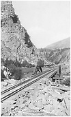 New or rebuild track, hewn ties, uneven roadbed on cribbing, four rails - time of conversion of track gauge with heavier standard gauge rail.<br /> D&amp;RG  Eagle River Canyon, CO  Taken by Brisbois, Leo - prob. 1890