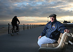 9-11 First Responder TJ Gilmartin, who suffers breathing problems, stands on the boardwalk in Spring Lake, New Jersey where he stays in his mother's apartment..