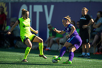 Orlando, Florida - Sunday, May 8, 2016: Orlando Pride forward Josee Belanger (9)  is defended by Seattle Reign FC defender Elli Reed (7) during a National Women's Soccer League match between Orlando Pride and Seattle Reign FC at Camping World Stadium.