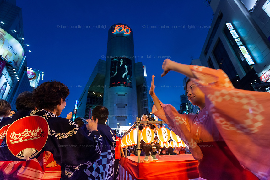 People in kimono dance in the street during the first ever Bon Odori festival held in Shibuya.Tokyo, Japan. Saturday August 5th 2017 The streets around the iconic 109 building were closed to traffic for the festival of traditional summer dancing.