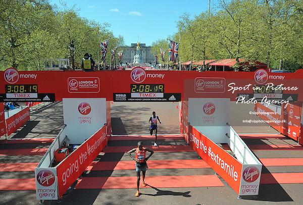 Mo Farah (GBR) croses the finish ine in the mens race. Virgin Money London Marathon. London. UK. 13/04/2014. MANDATORY Credit Garry Bowden/Sportinpictures - NO UNAUTHORISED USE - 07837 394578