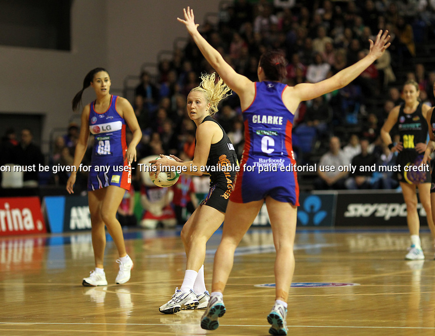 16.07.2012 Magic's Laura Langman in action during the ANZ Champs netball match between the Mystics and Magic played at the Trusts Stadium in Auckland. Mandatory Photo Credit ©Michael Bradley.