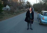 NWA Democrat-Gazette/ANDY SHUPE<br /> Sarah Marsh, Fayetteville City Council member, uses a tape measure Wednesday, Jan. 3, 2018, to measure the width of Oliver Avenue in Fayetteville to better understand options to improve the street and make it more walkable.