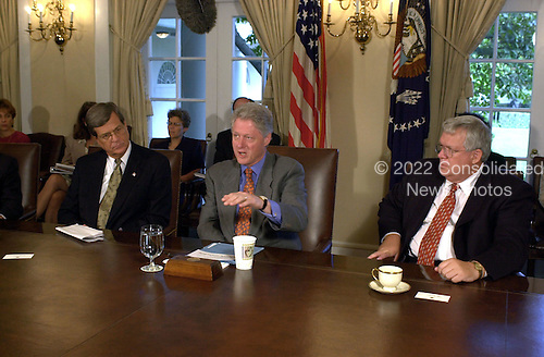 United States President Bill Clinton makes remarks as he meets with the Bipartisan Congressional Leadership in the Cabinet Room at the White House in Washington, D.C. on September 12, 2000.  From left to right: U.S. Senate Majority Leader Trent Lott (Republican of Mississippi), President Bill Clinton, Speaker of the U.S. House Dennis Hastert (Republican of Illinois)..Credit: Ron Sachs / CNP