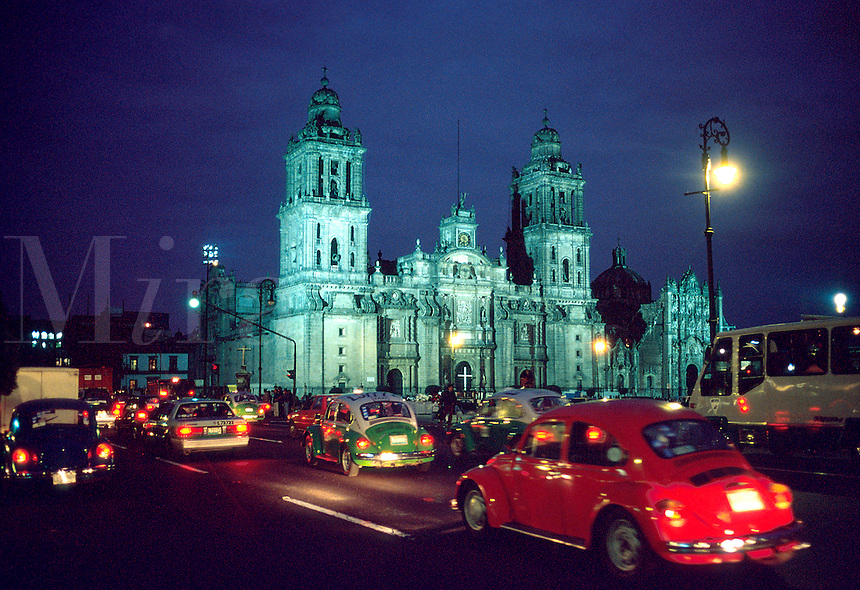 Evening rush hour traffic and the Zocalo. Mexico City.