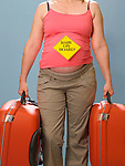 Pregnant woman carrying suitcases