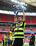 Huddersfield's Tommy Smith celebrates getting promotion during the Championship Play-Off Final match at Wembley Stadium, London. Picture date: May 29th, 2017. Pic credit should read: David Klein/Sportimage