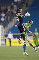 New England Revolution defender Ryan Cochrane (45) and Seattle Sounders forward Nate Jaqua (21) battle for head ball. In a Major League Soccer (MLS) match, the Seattle Sounders FC defeated the New England Revolution, 2-1, at Gillette Stadium on October 1, 2011.