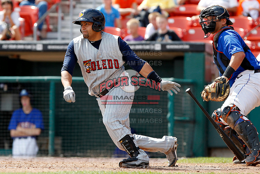 Toledo Mudhens catcher Omir Santos #24 at bat in front of catcher Raul Chavez #19 during a game against the Buffalo Bisons at Coca-Cola Field on August 17, 2011 in Buffalo, New York.  Buffalo defeated Toledo 4-2.  (Mike Janes/Four Seam Images)