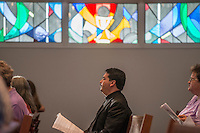 NWA Democrat-Gazette/ANTHONY REYES &bull; @NWATONYR<br /> The rev. Guillermo Castillo, with All Saints Episcopal Church in Bentonville, joins the congregation Thursday, May 14, 2015 for the Ascension Day service at St. Thomas Episcopal in Springdale. The church held a joint worship service with several local churches in Fayetteville.
