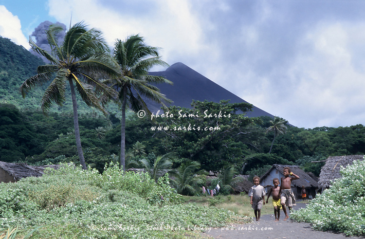 Melanesian boys walking by Yasur volcano, Sulphur Bay Village, Tanna Island, Vanuatu