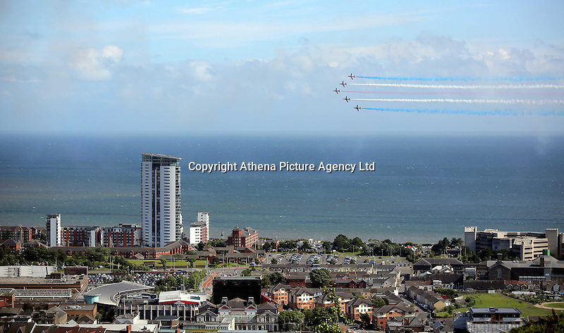 Swansea, UK. Saturday 02 July 2016<br />Aeroplanes of the Red Arrows perform aerobatic maneuvers and fly over Swansea Bay as part of the Swansea Air Show.