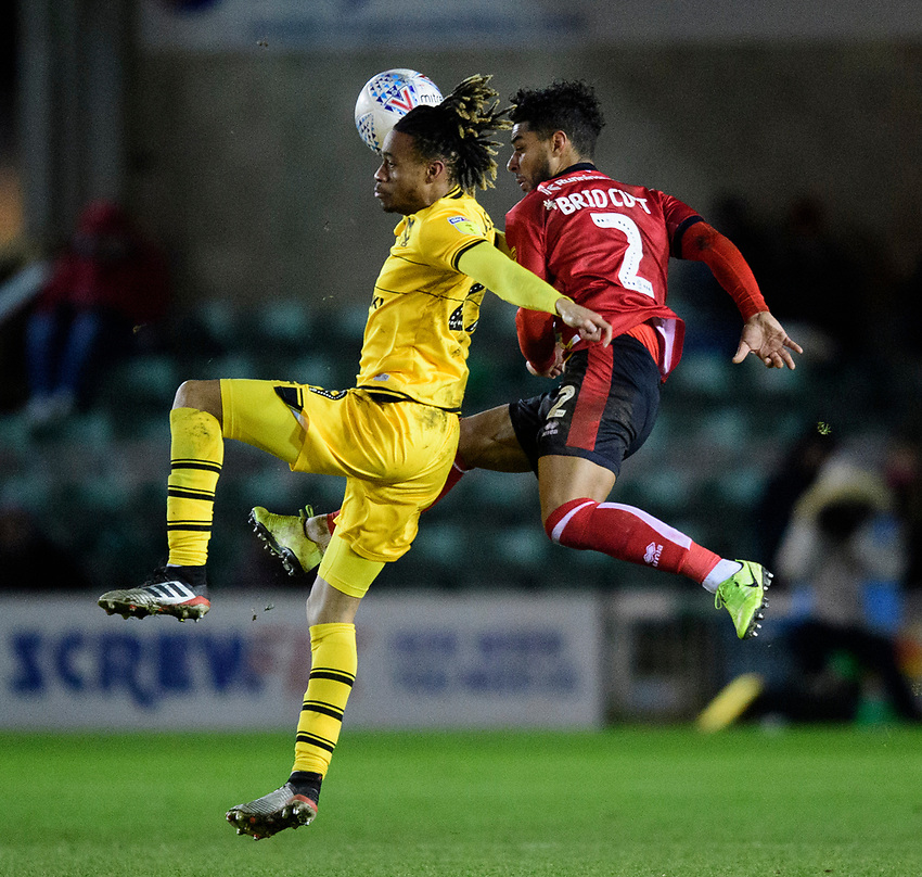 Lincoln City's Liam Bridcutt vies for possession with Milton Keynes Dons' David Kasumu<br /> <br /> Photographer Chris Vaughan/CameraSport<br /> <br /> The EFL Sky Bet League One - Lincoln City v Milton Keynes Dons - Tuesday 11th February 2020 - LNER Stadium - Lincoln<br /> <br /> World Copyright © 2020 CameraSport. All rights reserved. 43 Linden Ave. Countesthorpe. Leicester. England. LE8 5PG - Tel: +44 (0) 116 277 4147 - admin@camerasport.com - www.camerasport.com