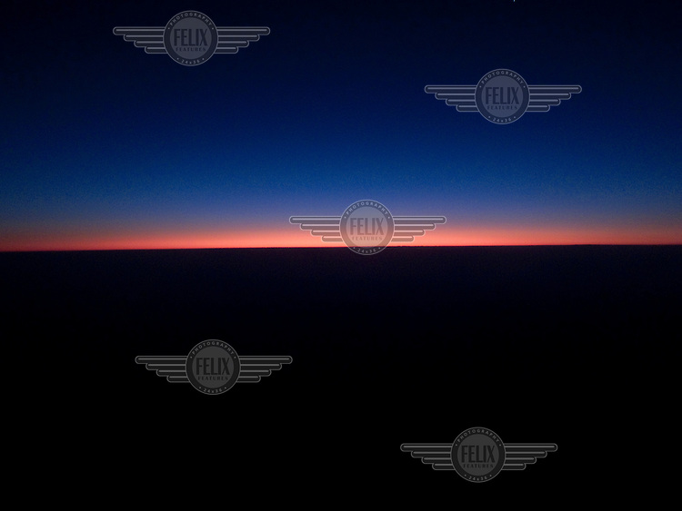Sunrise seen from an aeroplane flying over Europe...