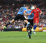 Diego Laxalt (left) of Uruguay and Cristian Roldan (7) of the United States leap for a header during an international friendly game  on September 10, 2019 at Busch Stadium in St. Louis, Missouri USA<br /> AFP Photo by Tim VIZER