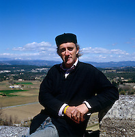 Philippe Brown on a terrace with the Provence landscape stretching out behind him