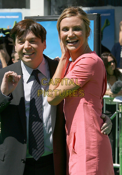 "MIKE MYERS & CAMERON DIAZ.Dreamworks ""Shrek The Third"" Los Angeles Premiere held at the Mann Village Theater, Westwood, California , USA, 06 May 2007..half length red pink coral dress rear hoop earrings suit tie.CAP/ADM/RE.©Russ Elliot/AdMedia/Capital Pictures."
