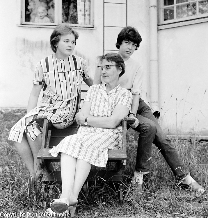 Portrait of two teenager girls and older woman who is hosting their stay in the countryside, Finland 1959