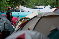 A participant among the tents on Sziget festival held in Budapest, Hungary on August 07, 2011. ATTILA VOLGYI