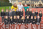 Kerry footballer Seamus Scanlon and pupils from Gaelcoil Aogain Castleisland who ran a lap each to contribute to the school running two marathons in two hours in An Riocht Castleisland on Monday to help raise funds for Rosaleen Higgins Special Olympics charity front l-r: Rosaleen Higgins, Seamus Scanlon. Back row: Sadhbh Prenderville,Mairead Phealan, Sarah Horgan, Sinead Murphy and Abbie Brosnan