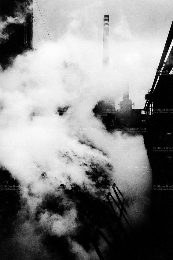 "Poland. Silesia. Chorsow. "" Hutta Kosciuszko "" is the factory's name. Coal pile and coke burning. Major polluted area due to old iron and steel works. Chorsow is a small town, distant 20 km from Katowice. © 1991 Didier Ruef .."